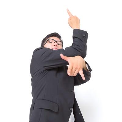 「平穏な生活を脅かされたビジネスマン」の写真素材