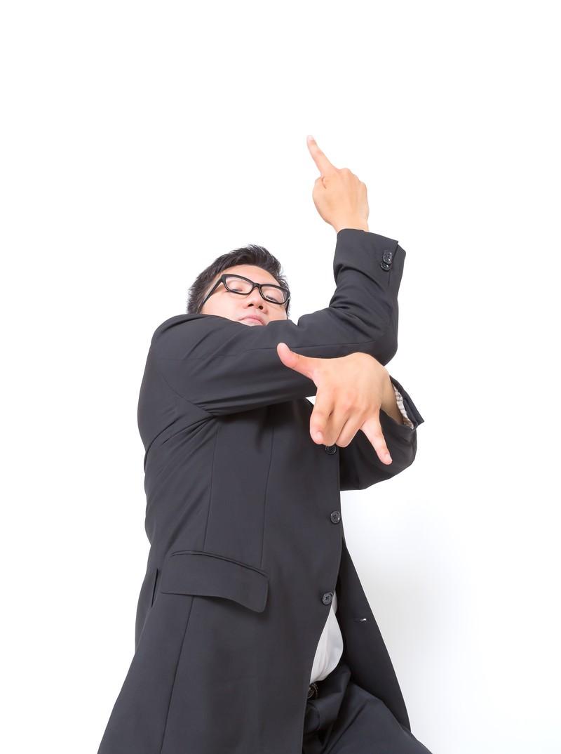 「平穏な生活を脅かされたビジネスマン」の写真[モデル:OZPA]