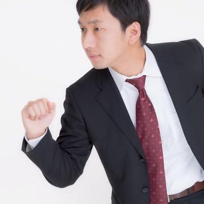 「走るビジネスマン」の写真素材