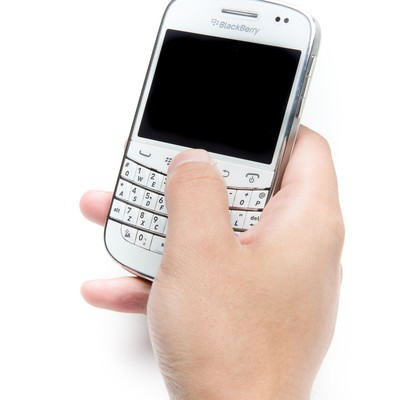 「片手でBlackBerryを操作」の写真素材