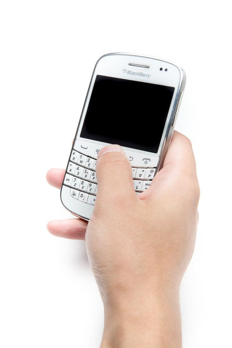 「片手でBlackBerryを操作片手でBlackBerryを操作」のフリー写真素材を拡大