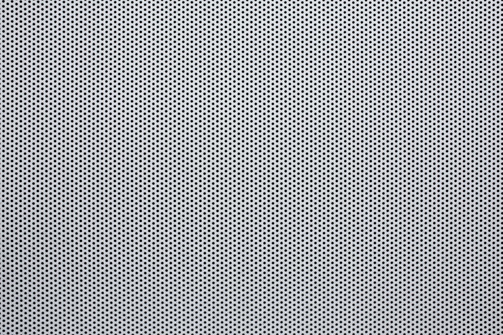 「丸穴が空いた板(テクスチャー)」の写真