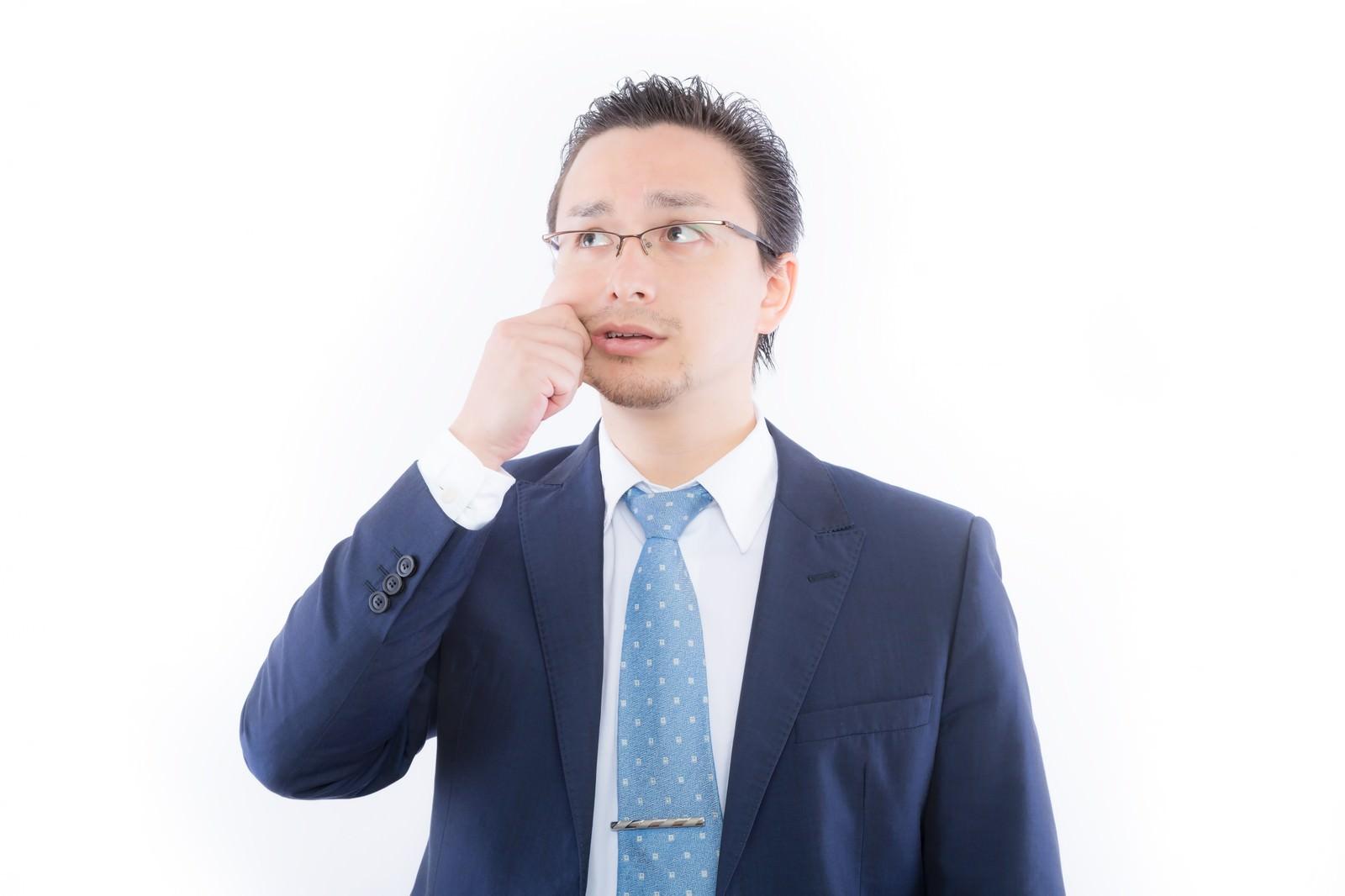 「頬をつねって現実を知る外国人」の写真[モデル:Max_Ezaki]
