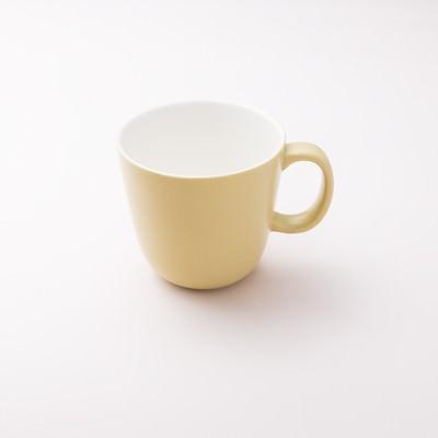 「黄色いカップ」の写真素材