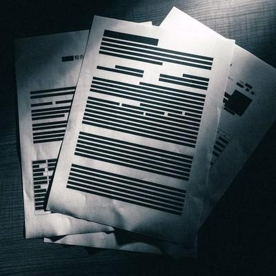 「ほとんど黒塗りされた重要機密書類」の写真素材