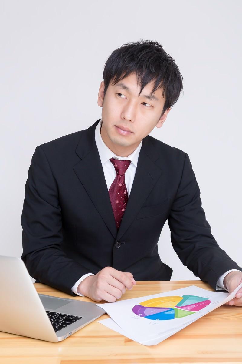 「やり手のマーケター」の写真[モデル:大川竜弥]