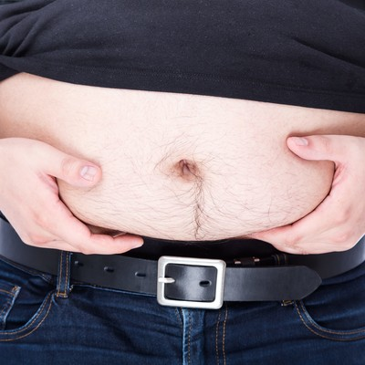 「お腹の脂肪がなかなか落ちない」の写真素材