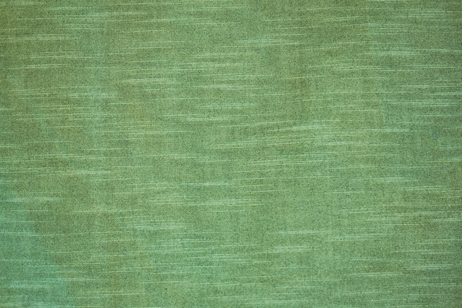 「ウグイス色の生地(テクスチャー)」の写真