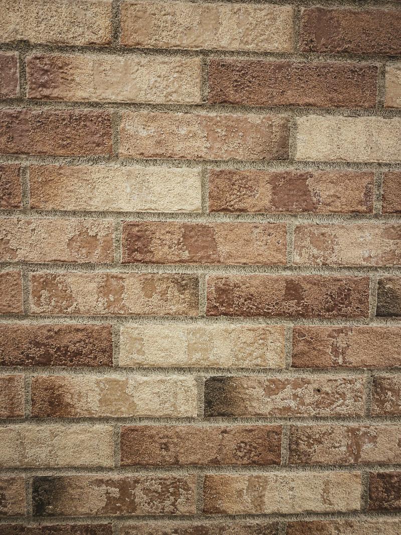 「色ムラがあるレンガの壁(テクスチャ)」の写真