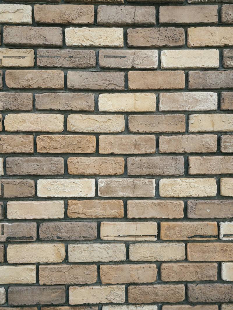 「黄土色のレンガ壁(テクスチャ)」の写真
