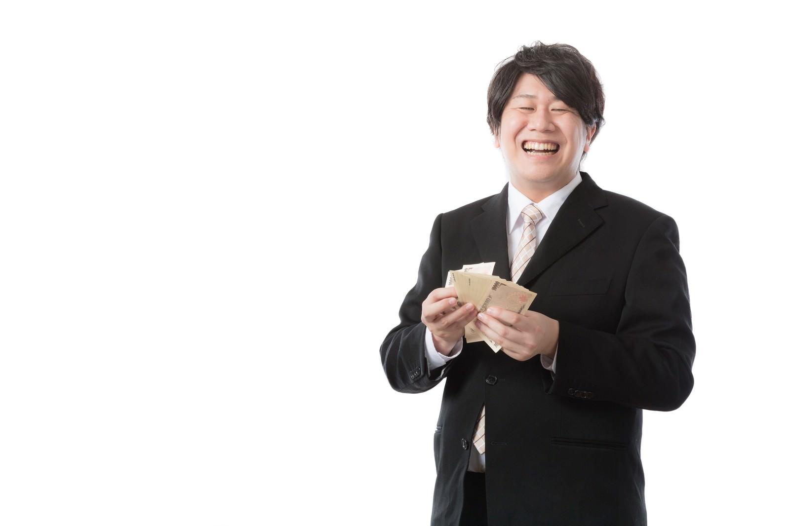 「秒速で札束をカウントする銀行職員」の写真[モデル:あまのじゃく]