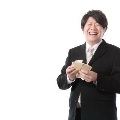 「秒速で札束をカウントする銀行職員」の写真素材