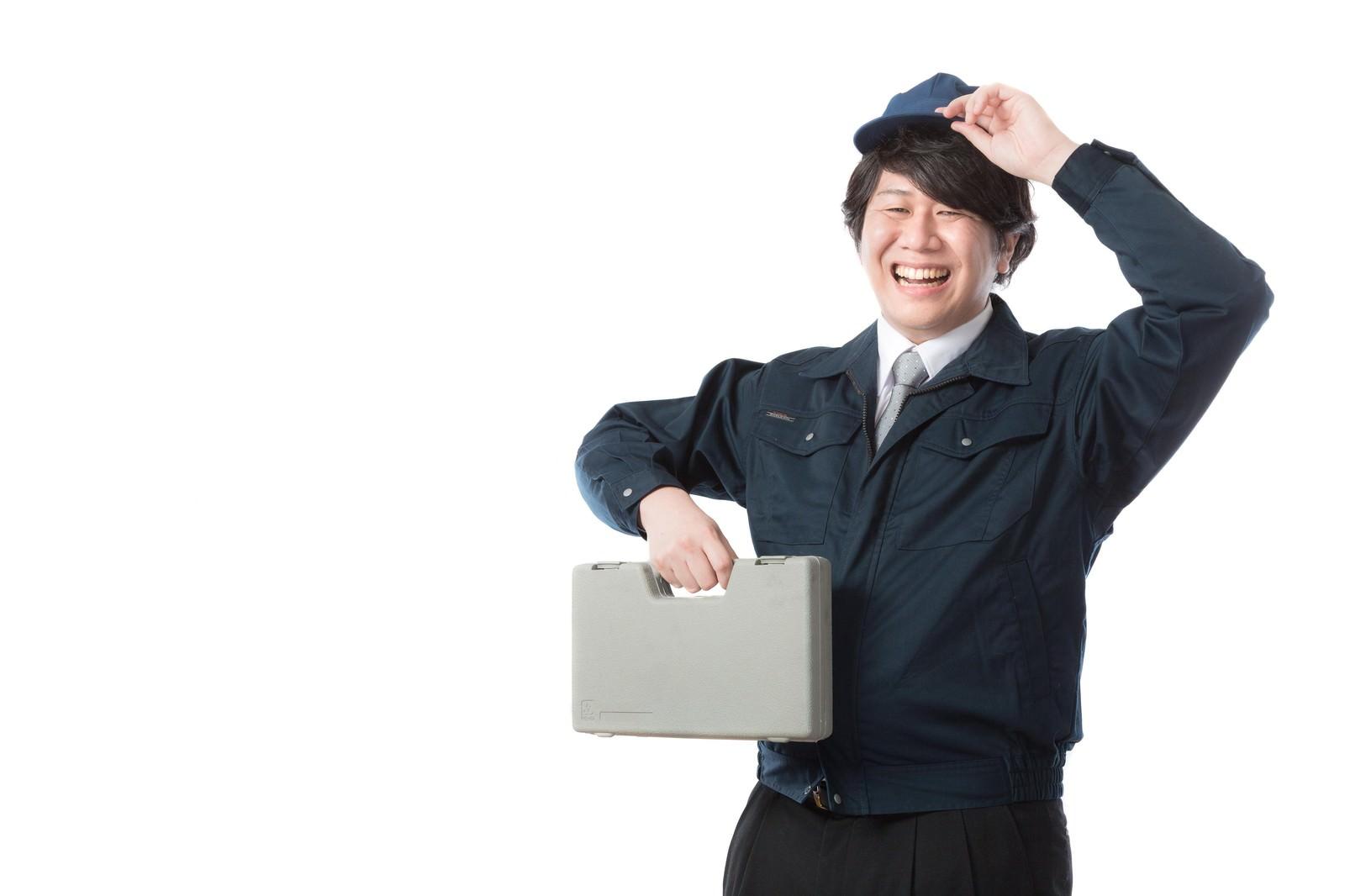 「オフィス機器のトラブルを解決するサービスエンジニア」の写真[モデル:朽木誠一郎]