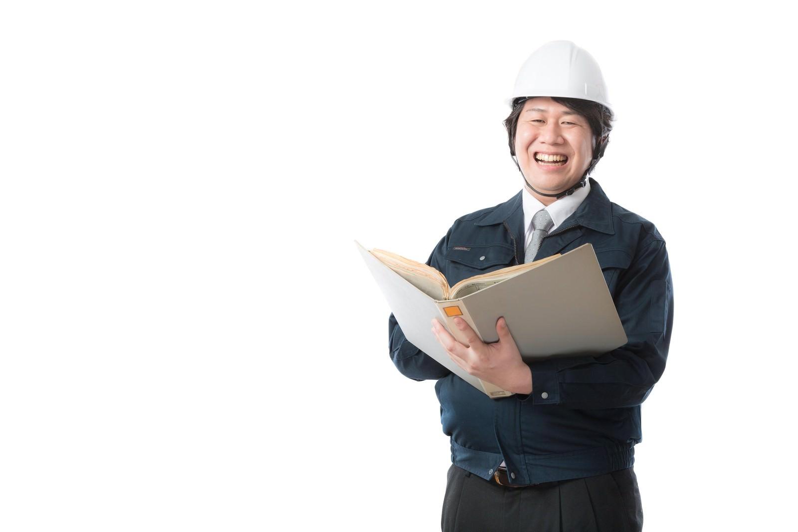 「国際的な競技場の設計監理を行う1級建築士」の写真[モデル:あまのじゃく]