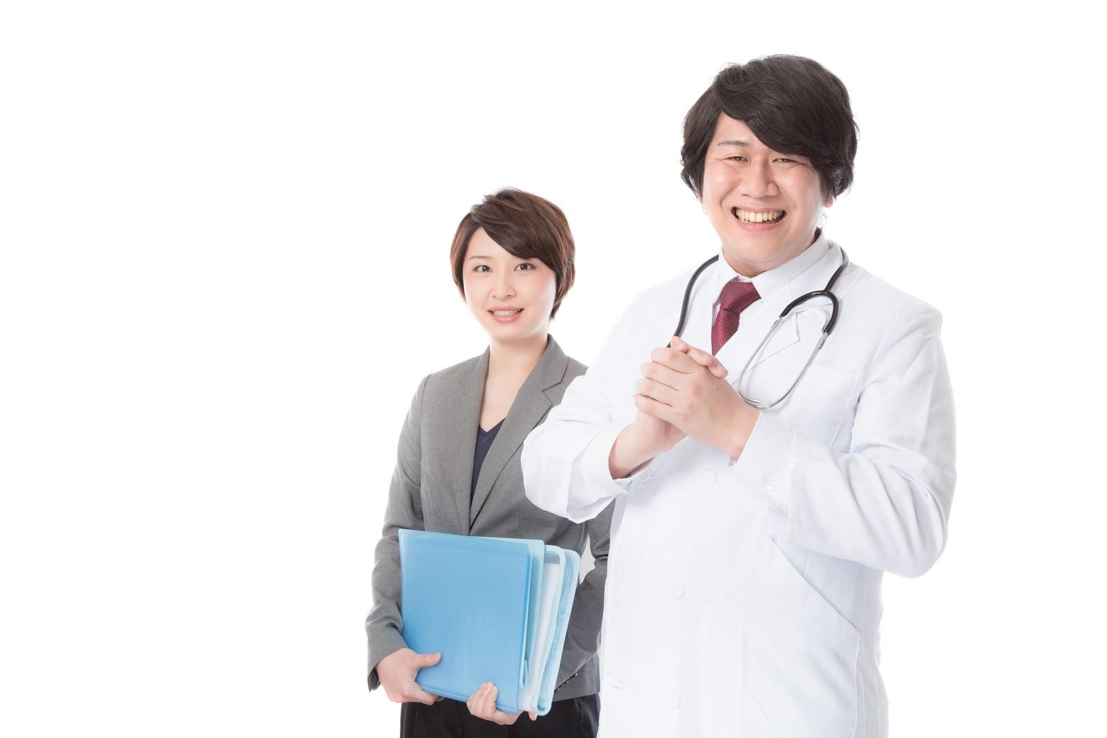 「病気の予防・治療のため医療機器を提案する営業担当病気の予防・治療のため医療機器を提案する営業担当」[モデル:八木彩香 朽木誠一郎]のフリー写真素材を拡大