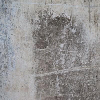 「汚れとシミがついたコンクリートの壁」の写真素材