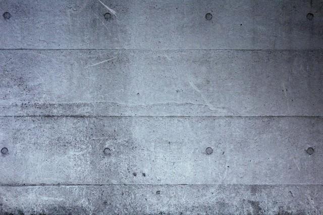 「冷たいコンクリートの壁(テクスチャー)」のフリー写真素材