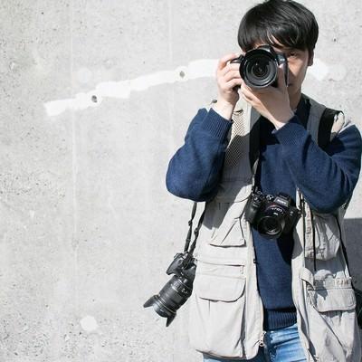 「複数台のカメラでガチ装備する報道」の写真素材