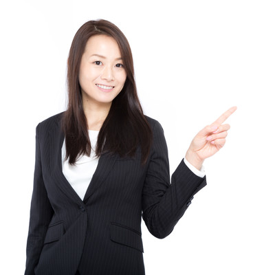 「指をさすビジネスウーマン」の写真素材
