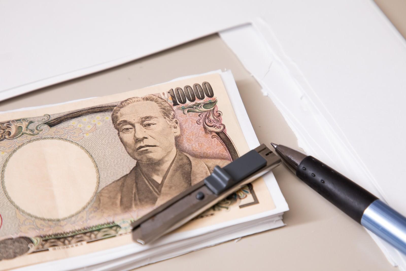 「紙幣(一万円)と同じ大きさにカットできました。」の写真