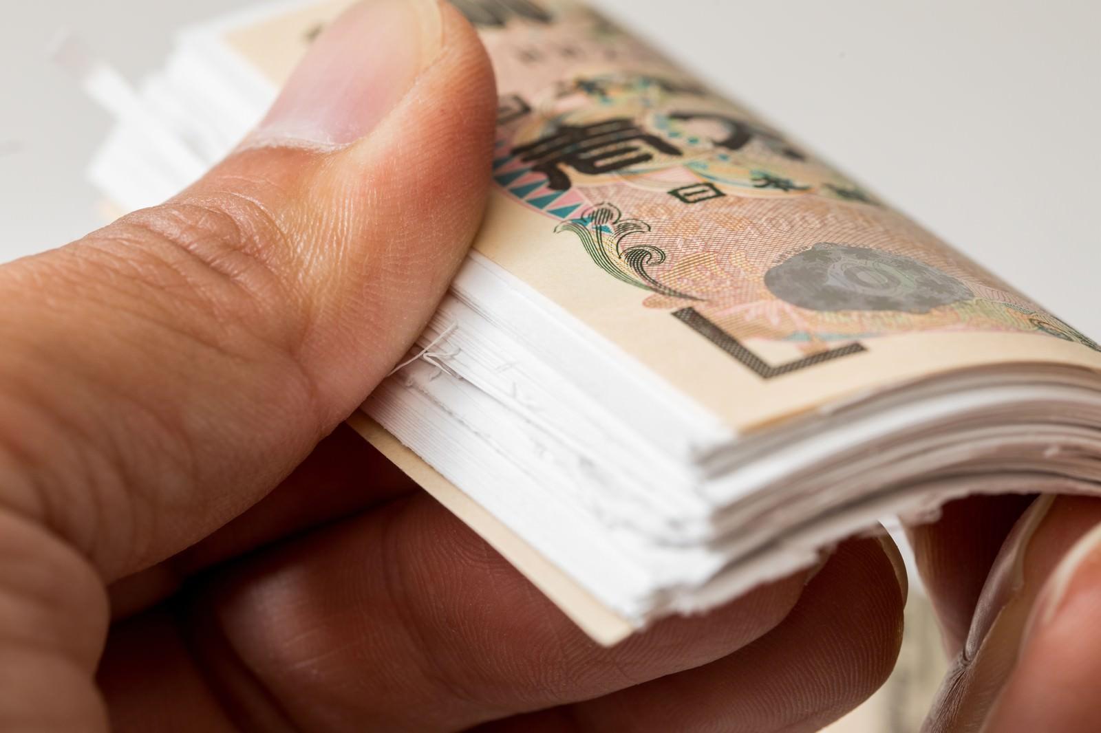 「どう見ても1万円どう見ても1万円」のフリー写真素材を拡大
