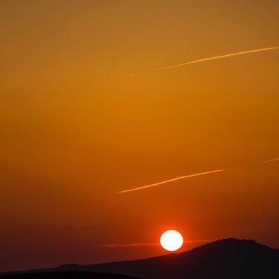 「阿蘇からの夕日」の写真素材