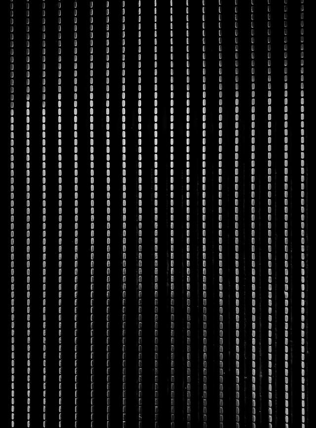 ステンレス鋼鉄の点線(テクスチャ)の写真