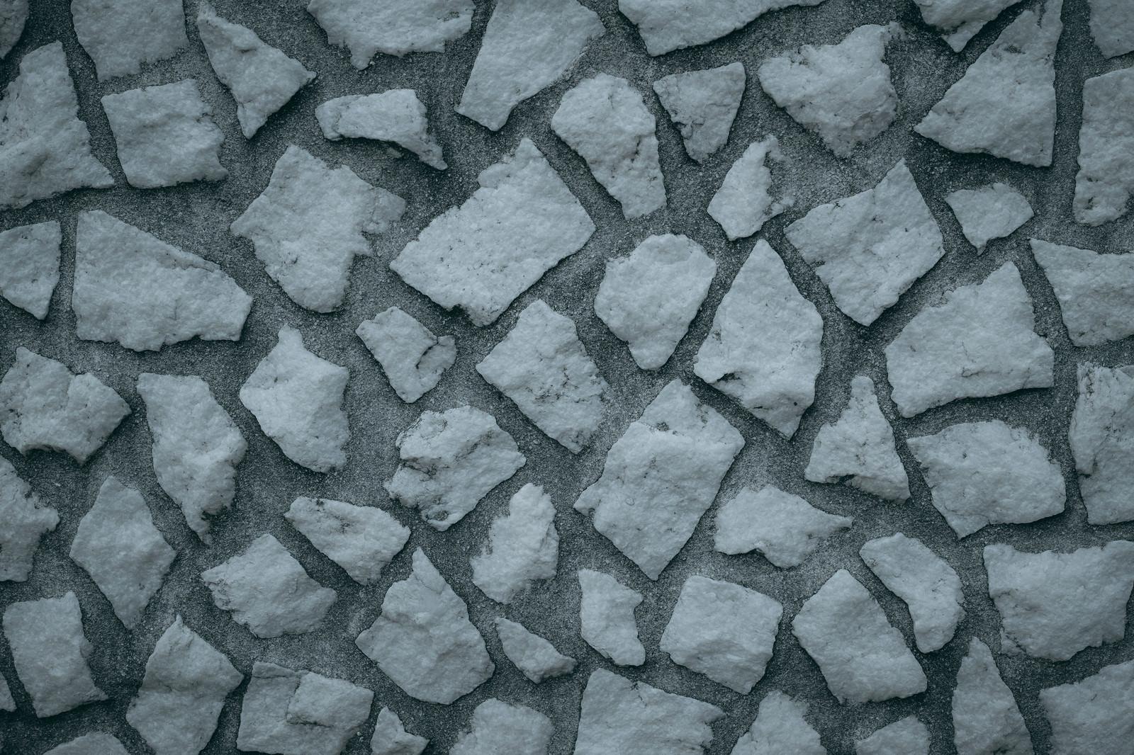 「乱雑に組み込まれた石の壁(テクスチャ)」の写真