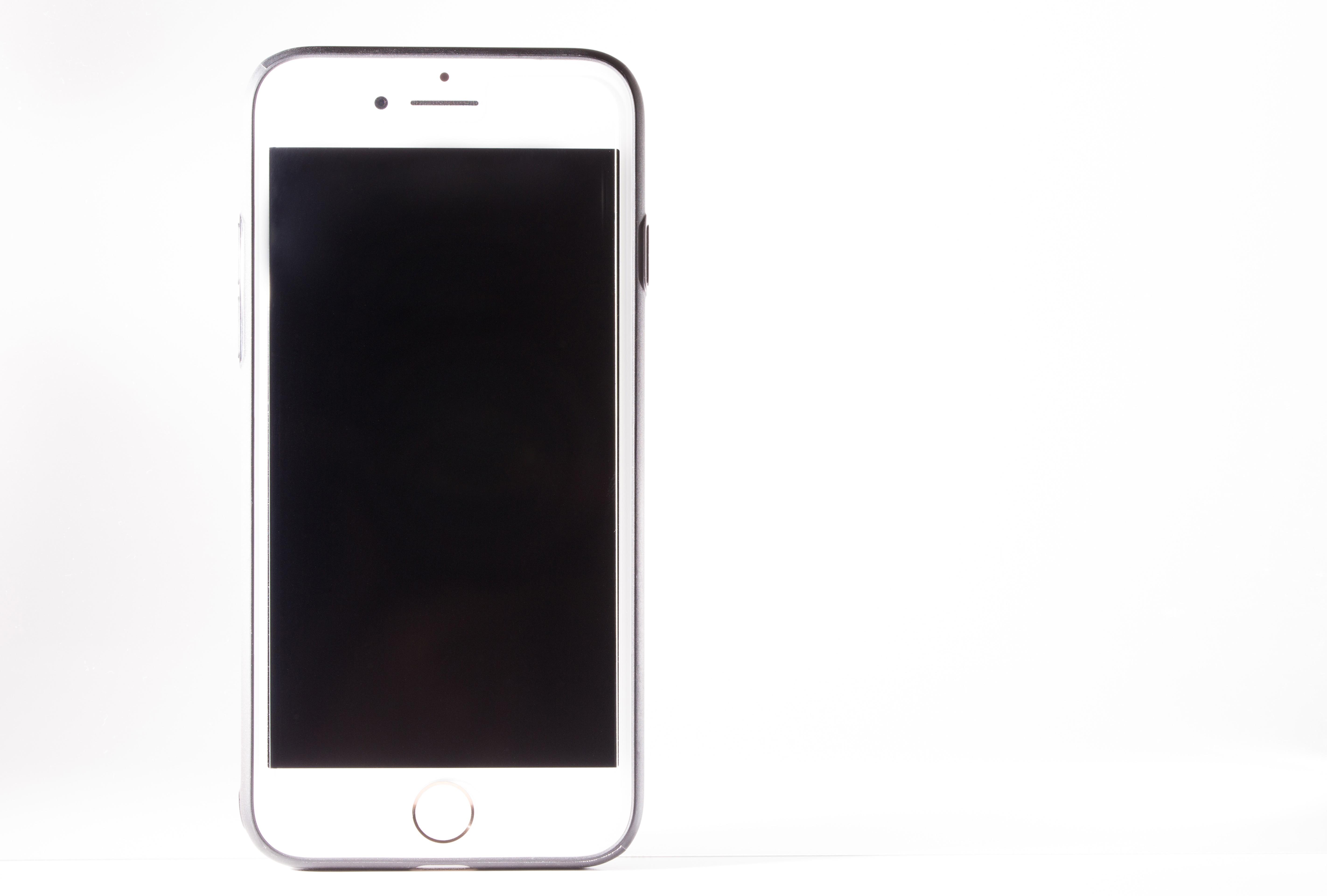 白背景とスマートフォン無料の写真素材はフリー素材のぱくたそ