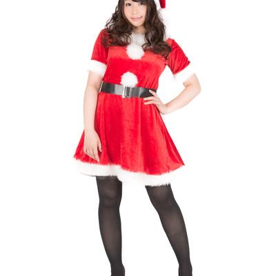 「サンタクロースの衣装を着たグラビアアイドル」の写真素材