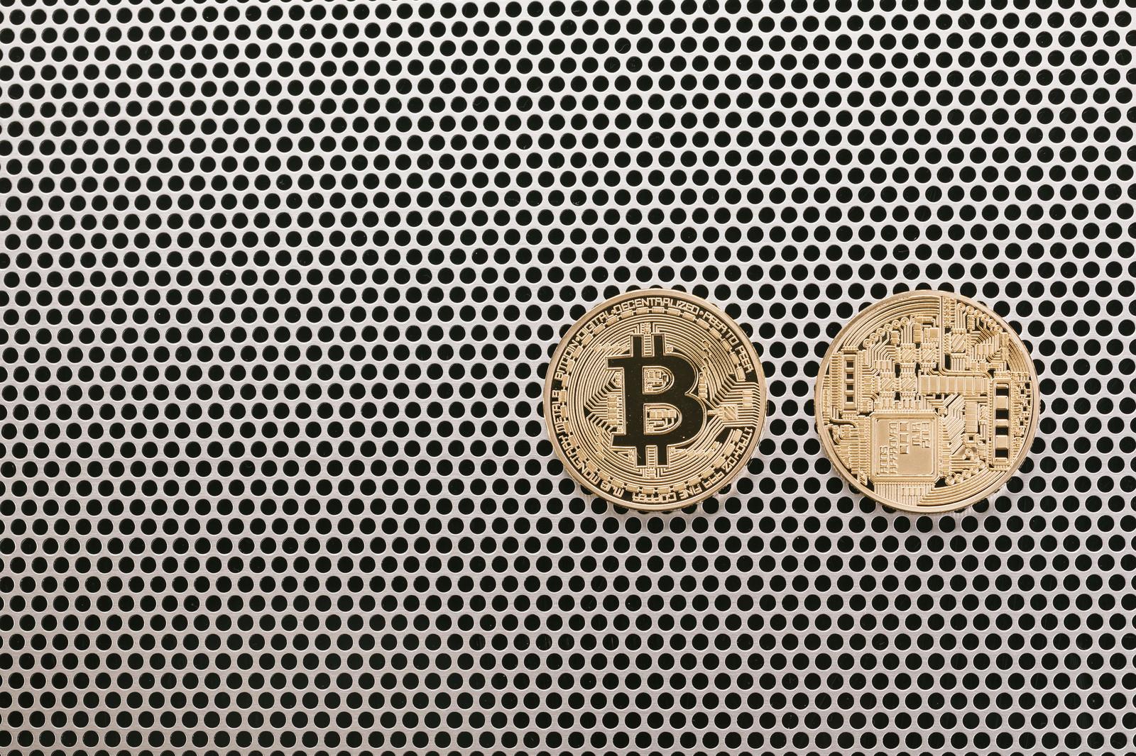 「仮想通貨の表と裏(Bitcoin)仮想通貨の表と裏(Bitcoin)」のフリー写真素材を拡大