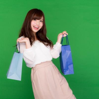「買い物はストレス発散女子」の写真素材