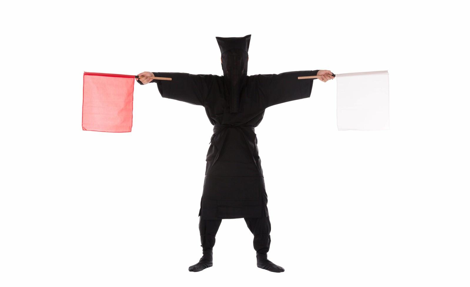 「黒子の手旗信号1」の写真[モデル:鈴木秀]
