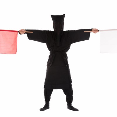 「黒子の手旗信号1」の写真素材