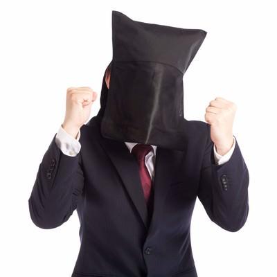 「匿名でも弱腰の営業マン」の写真素材