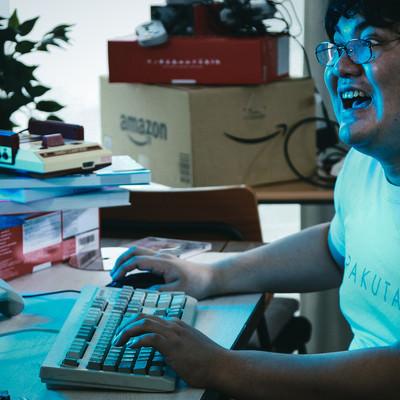 「自室に篭ってゲームばかりしているメタボ男子」の写真素材