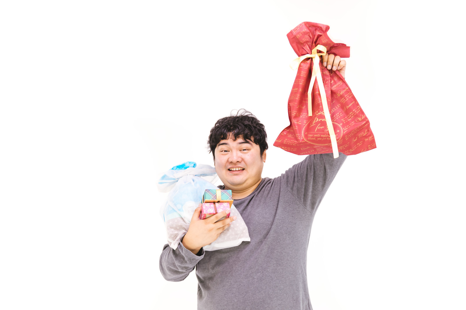 「これからプレゼント交換やりますー」の写真[モデル:段田隼人]