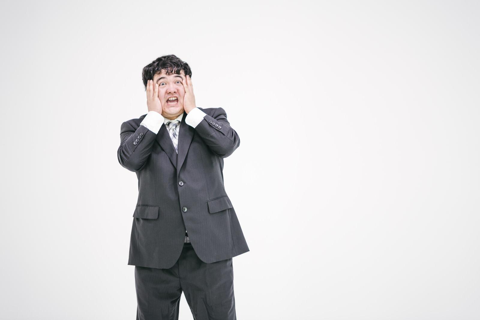 「社畜版あっちょんぶりけ」の写真[モデル:段田隼人]