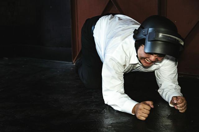 傷を負って仲間の助けを待つプレイヤーの写真