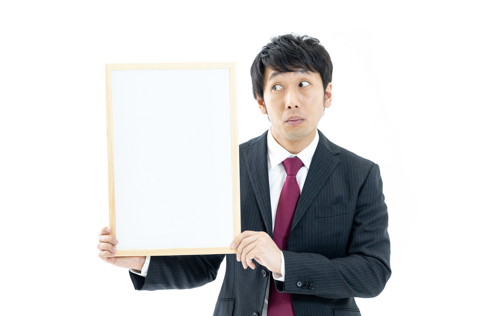 「クイズの答えが気になる司会者」の写真[モデル:大川竜弥]