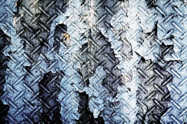 剥がれた塗装と金属(フォトモンタージュ)の写真