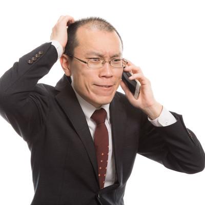 「ストレスによる抜け毛が著しいクレーム担当者」の写真素材