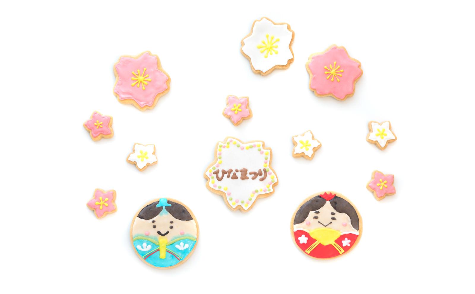 「梅の花に囲まれた男雛と女雛(クッキー)」の写真