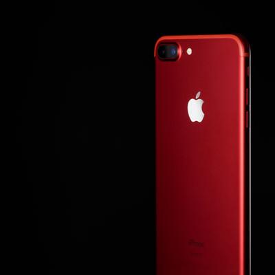 「エイズ対策プログラムの支援で発売された赤いカラーモデルのスマートフォン」の写真素材