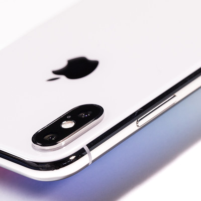 「iPhone X のサイドボタン」の写真素材