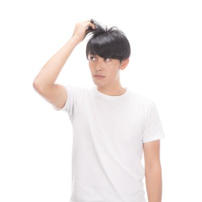 「髪の毛が細くなってきたなー」の写真素材