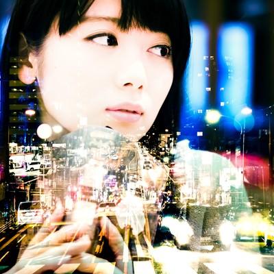 「遠距離恋愛(フォトモンタージュ)」の写真素材