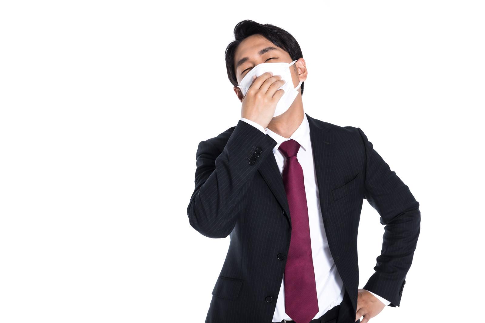 「インフルエンザでふらふらの会社員」の写真[モデル:大川竜弥]