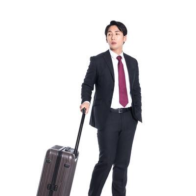 出張帰りのビジネスマンの写真