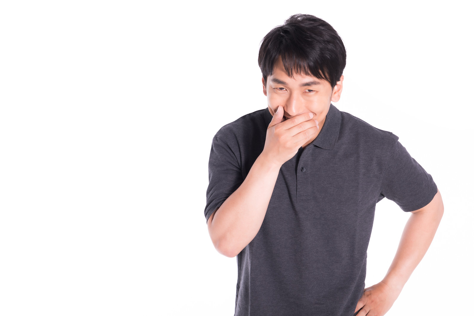 「ほくそ笑む男性」の写真[モデル:大川竜弥]